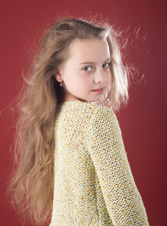 She got great style. small girl with long hair. Fashion portrait of little girl. beauty. kid hairdresser. Skin and hair care. childhood of happy kid. Looking trendy.