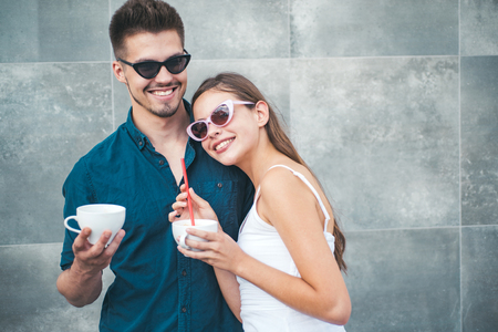 Coffee is ideal for conversation. Couple of woman and man with coffee cups. Girlfriend and boyfriend have espresso or latter drink. Couple in love drink coffee outdoor. Enjoying the best coffee date.