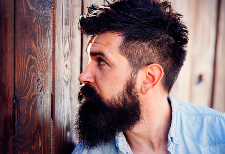 Must have beard. Handsome man with fashion beard and mustache. Bearded man with stylish hair. Barber shop or barbershop. Beard fashion trend. Barber is important in a mans life.
