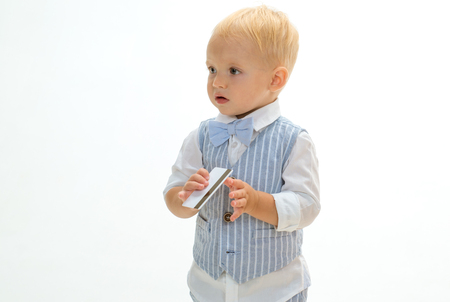 Confident and successful. Little cardholder. Boy child with credit card. Little boy keep business card. Small child do credit card payment. Money transaction. Getting business credit. Stock Photo