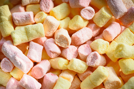 Unhealthy junk food. Colorful mini marshmallow background or texture. Marshmallow souffle with sweet flavor. Marshmallow recipe with sugar and gelatin. Sweet snack food. Chewing sweets. Фото со стока