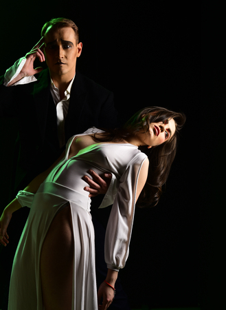 Greatest love story. Mime man and woman act in romantic scene. Couple of mime artists perform romance on stage. Couple in love with mime makeup. Theatre actors miming through body motions. 版權商用圖片