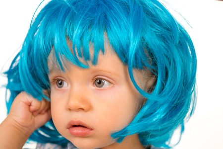 Funky style beauty. Cute baby with long blue hair. Small child wear blue wig hair. Small kid in fancy wig hairstyle. Adorable little child in fashion wig. Beauty look hairstyle for cosplay party. Archivio Fotografico - 118683828