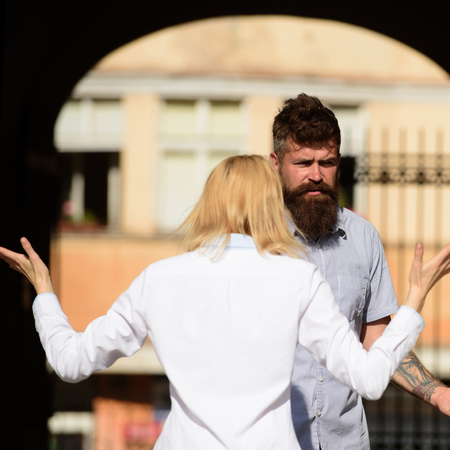 I dont understand you. Woman shouting and gesturing at bearded man. Couple in love quarreling on street. Conflict management in couple relationship. Conflict between lovers. Family conflict.