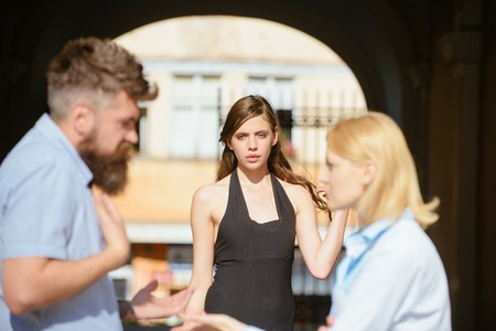 Its not my fault. Romance triangle and adultery. Jealous woman blaming unfaithful man for having a lover. Love triangle. Family conflict. Conflict in romantic relationship involving three people.