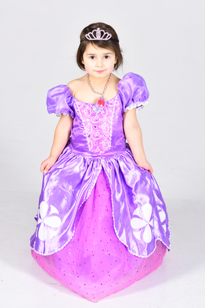 Little girl in princess dress. Childhood happiness. Childrens day. Small pretty child. Kid fashion. Little miss in beautiful dress. Party celebration in doll dress. Happy birthday. Cheeky little girl. Archivio Fotografico - 118683942