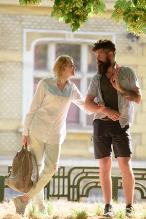 Enjoying summer together. Couple of hipster and sensual woman dating outdoor. Couple in love on summer day. Sexy woman and bearded man enjoy romantic date. Love and romance.