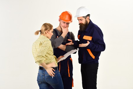 Concentrated on their project. People designers working on construction design. Construction workers team. Group of constructing engineers or architects at work. Men and woman builders work in team. Stock Photo