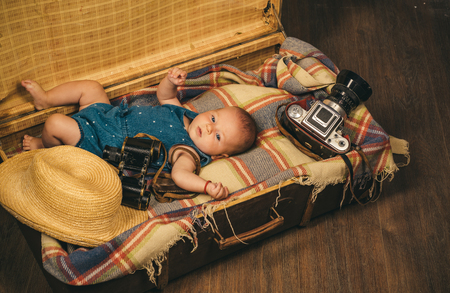 Portrait of happy little child. Sweet little baby. New life and birth. Family. Child care. Small girl in suitcase. Traveling and adventure. Childhood happiness. Photo journalist.