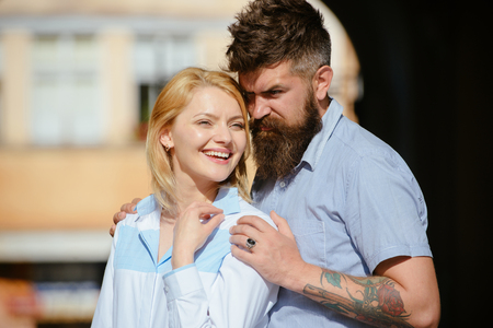 Close relationship. Loving couple of woman and hipster dating outdoor. Bearded man hug sexy girl. Sensual woman and man enjoy romantic date. Couple in love on summer day. Feeling love and romance.
