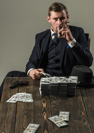Money transaction. Businessman work in accountant office. Economy and finance. Man bookkeeper. Man in suit. Mafia. Making money. Small business concept. Using modern technologies at work. Reklamní fotografie