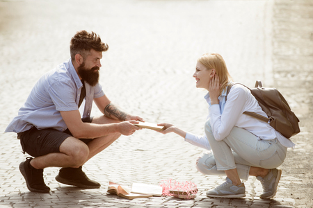 Sexual attraction. Couple in love on summer street. Hipster helping and looking at girl. Bearded man and woman falling in love. Love at first sight. Romantic date and dating.