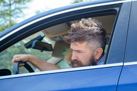 Eco driving is an ecologic driving style. Bearded man travel by automobile transport. Hipster enjoying road trip. Eco friendly and sustainable travel. Travelling by road transport. Using green energy.