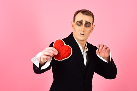 Being full of passion and drama. Mime actor with love symbol. Theatre actor pantomime falling in love. Love confession on valentines day. Mime man hold red heart for valentines day. Banco de Imagens