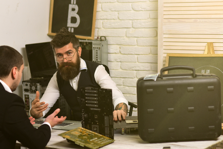 Accepting Bitcoin today will make your business ready for tomorrow. Businessmen in office with bitcoin symbol. Bearded man and customer negotiate a deal. Company manager and man have business meeting.