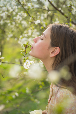 Pleasant spring day. Woman with fashion makeup. Summer girl with long hair. face and skincare. Travel in summer. Spring woman. Springtime and vacation. blossom. Natural beauty and spa therapy.