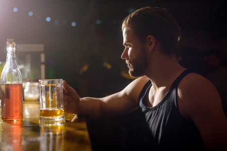 Refreshing beer to drink right now. Alcohol addiction and bad habit. Man drinker in pub. Handsome man drink beer at bar counter. Alcohol addict with beer mug. Addicting to alcoholic drink. Standard-Bild - 118684422