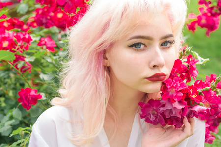 Spring in my head. girl with summer makeup. Makeup cosmetics and skincare. Spring woman with flowers. Summer beauty. Fashion portrait of woman. hair coloring.