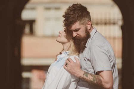 Moments of intimacy. Bearded man hug sexy girl. Sensual woman and man enjoy romantic date. Couple in love on summer day. Loving couple of woman and hipster dating outdoor. Feeling love and romance.