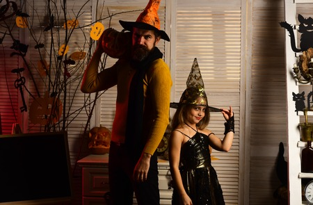 Father and small kid celebrate halloween. Small kid and father dressed for halloween party. We love halloween. Trust us we are monsters.