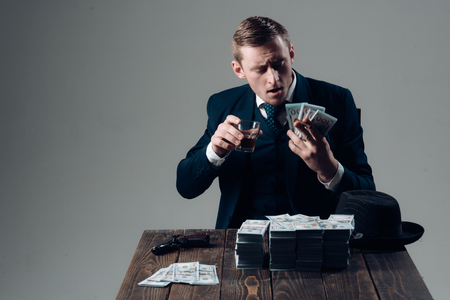 Small business concept. Man in suit. Mafia. Making money. Businessman work in accountant office. Economy and finance. Man bookkeeper. Money transaction. Rich and successful. Stock Photo