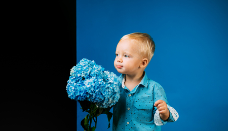 Spring flowers. Childhood. Childrens day. Small baby boy. New life concept. Spring holiday. Summer. Mothers or womens day. Little boy at blooming flower. Express positivity. Imagens - 118381661