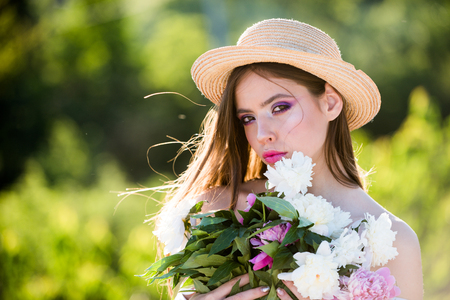 Spring woman. Spring in her basket. Springtime and vacation. face and skincare. Travel in summer. Woman with fashion makeup. Natural beauty and spa therapy. Summer girl with long hair.