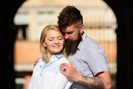 Two hearts full of love. Sensual woman and man enjoy romantic date. Bearded man hug sexy girl. Couple in love. Loving couple of woman and hipster dating outdoor. Feeling love and romance. Banque d'images - 117756133