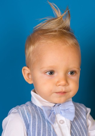 A perfect cut. Boy child with stylish blond hair. Healthy hair care habits. Small child with messy top haircut. Small boy with stylish haircut. Hair styling products. Stock Photo - 118381728