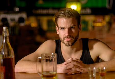 I like to go to pubs. Man drinker in pub. Addicting to alcoholic drink. Handsome man drink beer at bar counter. Alcohol addict with beer mug. Beer restaurant. Alcohol addiction and bad habit. Stock Photo