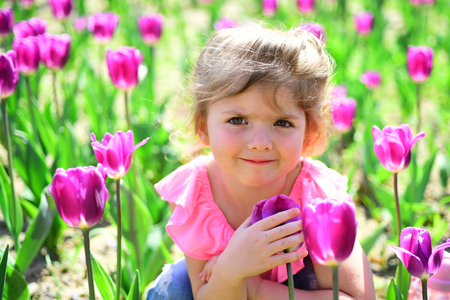 Little girl in sunny spring. Summer girl fashion. Happy childhood. face and skincare. allergy to flower. Springtime tulips. weather forecast. Small child. Natural beauty. Childrens day. Forever young