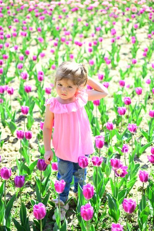 Spring style. face and skincare. allergy to flowers. Summer girl fashion. Happy childhood. Little girl in sunny spring. Small child. Natural beauty. Childrens day. Springtime tulips. weather forecast.