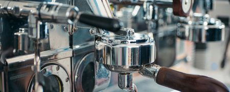 Espresso machine parts. Commercial coffee machine. Coffee maker in coffee shop. Stainless steel cooking appliance to brew coffee. Espresso being brewed in cafe. All your favourite coffees.