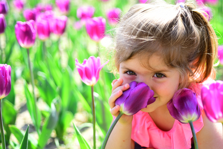 Impossible scent. face skincare. allergy to flowers. Summer girl fashion. Happy childhood. Little girl in sunny spring. Small child. Natural beauty. Childrens day. Springtime tulips. weather forecast. 版權商用圖片