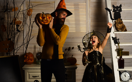 Little girl and wizard man enjoy halloween. Little girl in wizard hat have fun with father. Have a frightfully spooky HalloweenHang around for a spell.