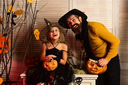 Happy family enjoy halloween party. Father and daughter celebrate halloween party. Father and child prepared for costume party. We need a family fun night. Happy haunting.