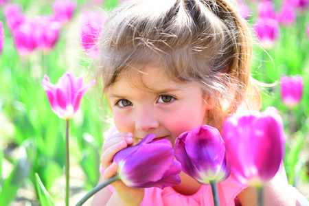 Spring mood. face and skincare. allergy to flowers. Springtime tulips. weather forecast. Summer girl fashion. Happy childhood. Little girl in sunny spring. Small child. Natural beauty. Childrens day.