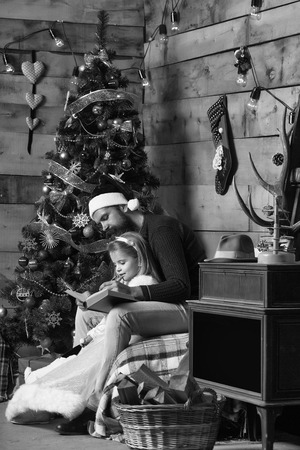 christmas bearded father and girl reading