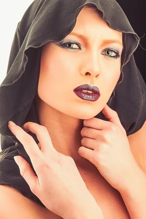 Portrait of beautiful girl under black hood. 写真素材 - 117188310