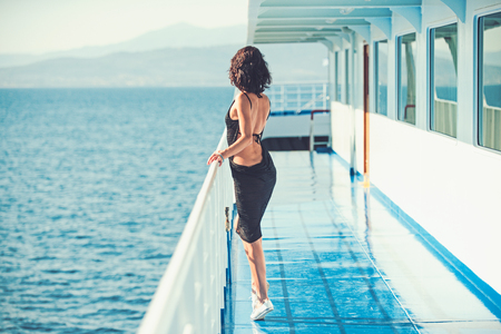 Summer vacation and travel to ocean. Girl on ship deck in fashion swimsuit. Fashion and beauty look. Marine traveling and boat trip. Sexy woman travel by sea and looking far away