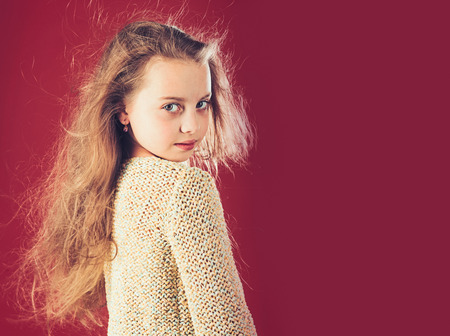 Fashion portrait of little girl. small girl with long hair. kid hairdresser. Skin and hair care, copy space.. Loving her new style. In her own style. childhood of happy kid. beauty Stock Photo