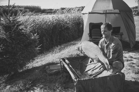 Fishing adventures, carp fishing Archivio Fotografico - 117189662