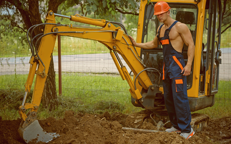 Excavation concept. Man operated excavator for ground excavation. Digger operator work on excavation site. Excavation and construction