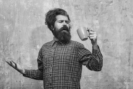 singing bearded man pulling stylish fringe hair with blue cup