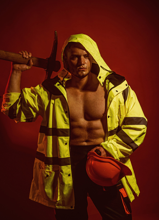 Temporary under construction. Construction worker or man miner with mining equipment. Muscular man worker. Hard worker with muscular torso. Mining area under construction Фото со стока