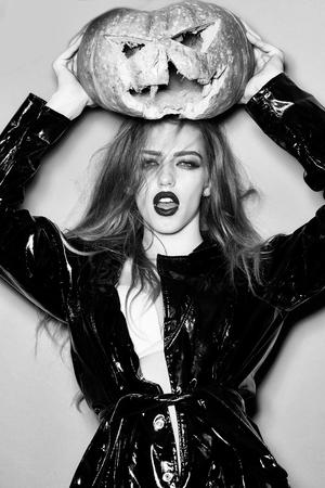 Pretty woman with halloween pumpkin