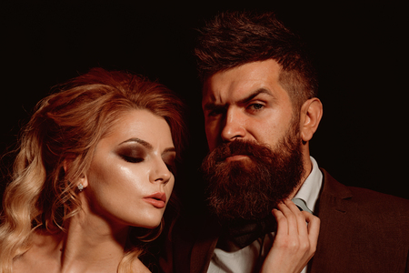 Worthy of taking out on a date. Bearded man and sexy woman on first date. Couple of man and woman date on valentines day. Couple in love. Happy valentines day. Love is blind