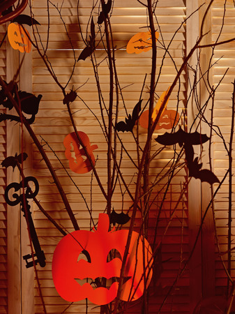 Halloween party decorations. Halloween symbols hang on tree. Caution, low flying bats. Happy spooky halloween. Please come in for a bite Stock Photo