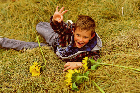 Happy boy. Small boy happy smiling in hay. Small boy smile and show ok sign. OK, Im happy 写真素材