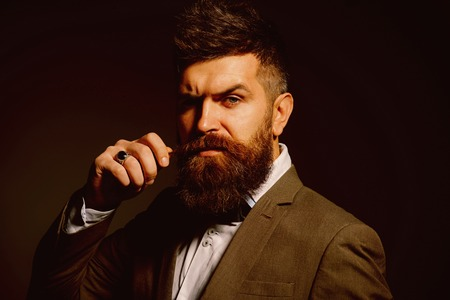 People in fashion treat it as a business. Bearded man after barber shop. Man with long beard in business wear. Business as usual. Mens fashion. Barber in shop